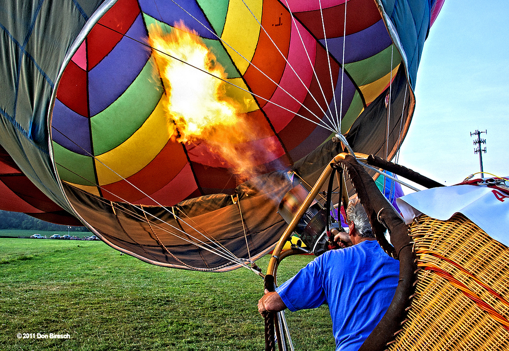 A man inflates a hot air balloon in a most badass way ©2012 Don Biresch